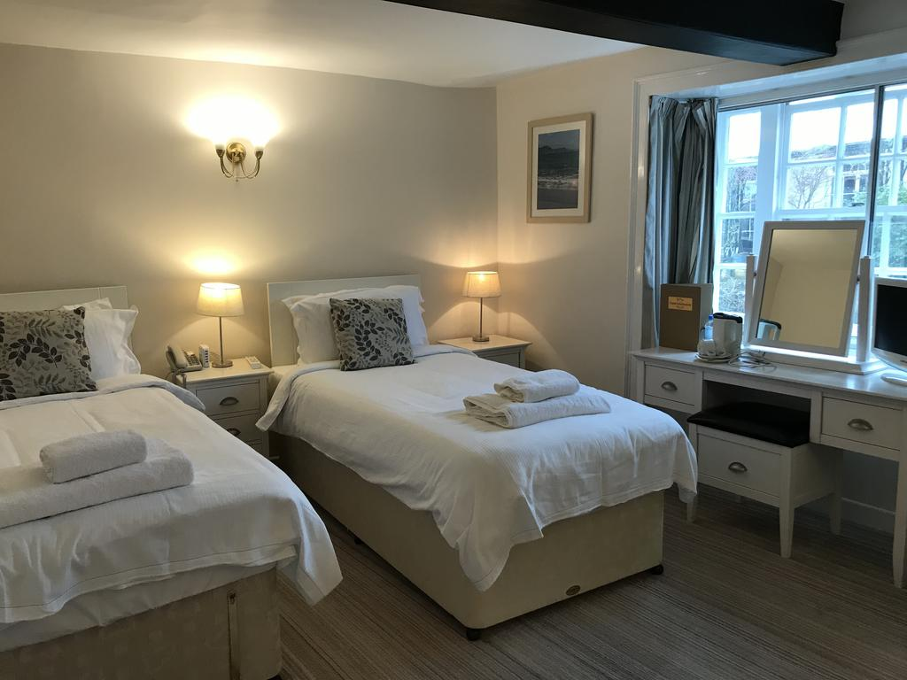 a twin room at the mariners hotel lyme regis